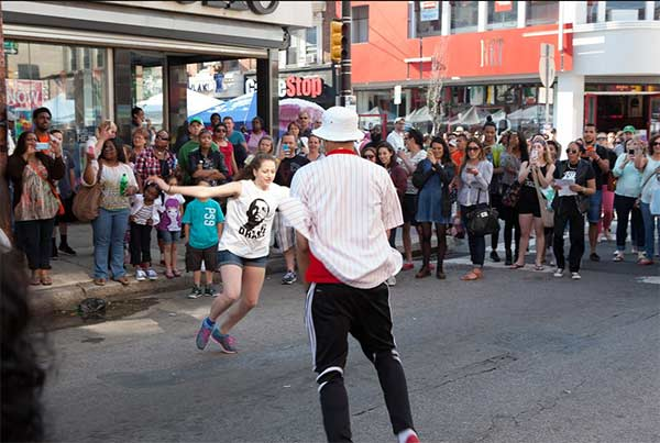 "Romance was in the air at the South Street Spring Festival as a flash mob, comprised of student dancers from the High School for the Creative and Performing Arts, helped Freddie propose to his girlfriend Erika to Bruno Mars' tune ""Marry Me!"" When Freddie dropped to his knee Erika said ""Yes"" and the crowd erupted in applause. (Pictures courtesy of South Street Headhouse District)"