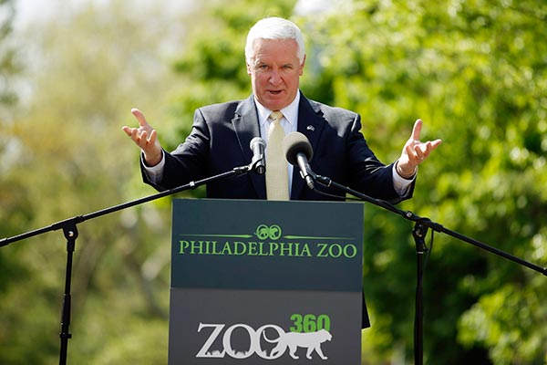 Pennsylvania Gov. Tom Corbett speaks during a news conference at the Philadelphia Zoo, Wednesday, May 7, 2014, in Philadelphia. The zoo opened a see-through mesh pathway called Big Cat Crossing and is part of a national trend called animal rotation that zoos use to enrich the experience of both creatures and guests. (AP Photo/Matt Slocum)