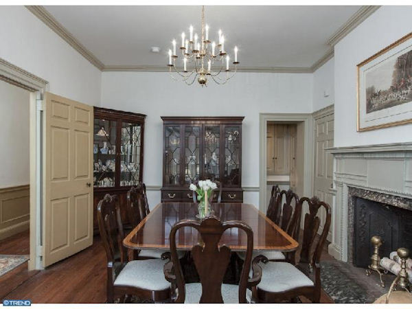 Pictured: The $1.8 million property at 415 Pine Street in the Society Hill section of Philadelphia.      From the listing on McCannTeam.com: Federal style historic 1790s townhome lovingly restored during 2007-09. Many unique details lie within this spacious and gracious 5 BR, 3.2 bath home including original pine floors, six fireplaces, crown moldings, period hardware. Open living room, dining room and breakfast room w/ built-in shelving and cabinetry. Beautiful new custom kitchen w/ 2 work stations, stainless steel appliances, granite counters, skylights and stone flooring. Built-in computer desk and cabinets off kitchen. Sunroom w/ Franklin stove leads to charming private yard. 2nd floor w/ full bath, laundry rm and fantastic Master Suite w/ gas fireplace, a walk-in plus two additonal closets. Second BR with 1/2 bath leads to the 3rd level with FR w/ built-in wet bar, refrig/freezer, fireplace and flat screen TV as well as 3rd full bath and 3rd BR w tons of closet space and beautiful views. 4th level has 4th and 5th bedrms w/ built-ins and custom closets. Basement w/dog bath + lots of storage. High velocity AC t/o. A true MUST-SEE! One year prepaid two car parking!