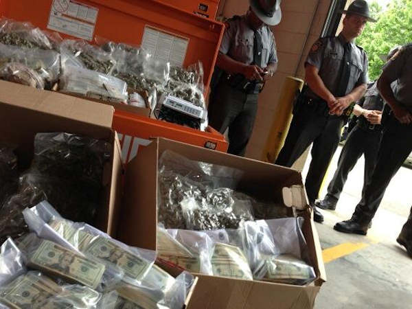 "<div class=""meta ""><span class=""caption-text "">May 23, 2013: Pennsylvania State troopers stand near drugs, cash seized in a Montgomery County drug bust. (Action News reporter Annie McCormick)</span></div>"