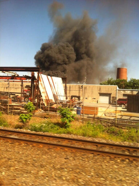 Fire broke out at Automated Waste Solutions Inc. in Southwest Philadelphia resulting in smoke filling the air on Tuesday, June 4, 2013. (Megan Crow/ Twitter)