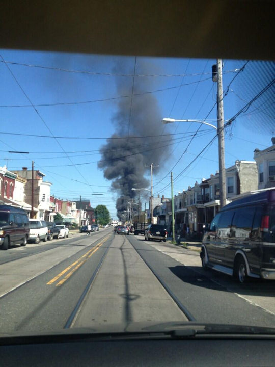 Fire broke out at Automated Waste Solutions Inc. in Southwest Philadelphia resulting in smoke filling the air on Tuesday, June 4, 2013. (Natasha Silver/ Twitter)