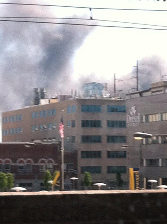 Fire broke out at Automated Waste Solutions Inc. in Southwest Philadelphia resulting in smoke filling the air on Tuesday, June 4, 2013. (Cindy/ Twitter)