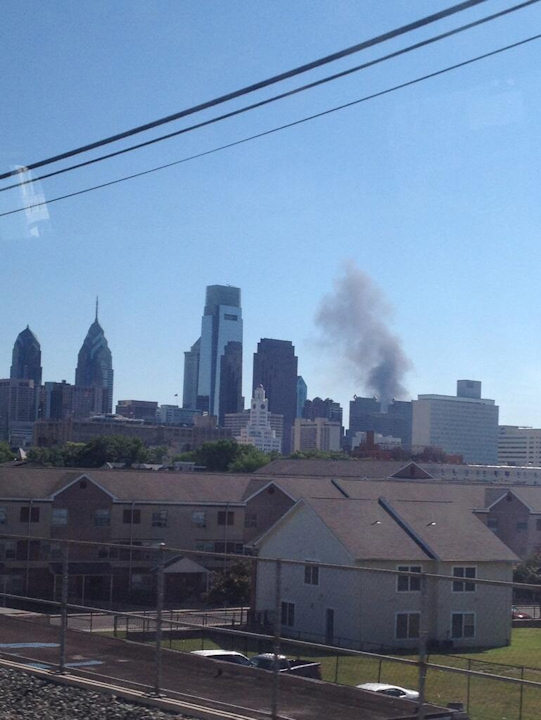 Fire broke out at Automated Waste Solutions Inc. in Southwest Philadelphia resulting in smoke filling the air on Tuesday, June 4, 2013. (Justin Twitter)