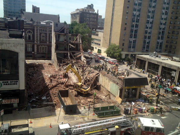 "<div class=""meta image-caption""><div class=""origin-logo origin-image ""><span></span></div><span class=""caption-text"">Rescue personnel work the scene of a building collapse in Center City Philadelphia, Wednesday, June 5, 2013.  (AP Photo/Jacqueline Larma)</span></div>"