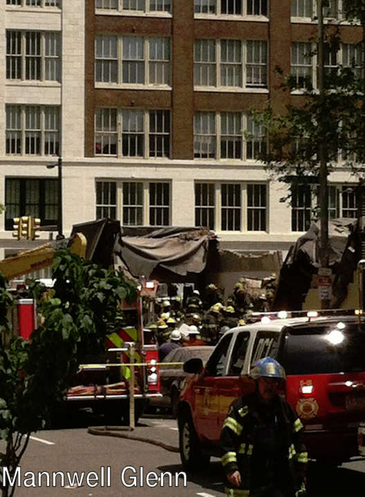 "<div class=""meta image-caption""><div class=""origin-logo origin-image ""><span></span></div><span class=""caption-text"">Mannwell Glenn posted this photo on Facebook of the building collapse on 22nd and Market streets on June 5, 2013. </span></div>"