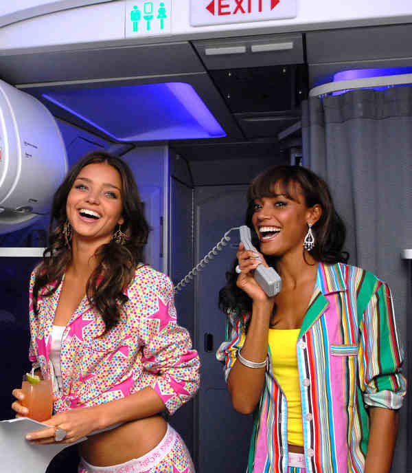 In this photo released by Virgin America, Victoria&#39;s Secret Supermodels Miranda Kerr, left, and Selita Ebanks welcome passengers aboard the first ever in-flight PJ party and fashion show on Virgin America&#39;s flight 317 from New York&#39;s JFK International Airport to LAX, on Wednesday Nov. 28, 2007. Virgin America is the official &#34;Airline of the Angels&#34;. &#40;AP Photo&#47;Virgin America, Bob Riha, Jr.&#41; <span class=meta>(AP Photo&#47;Virgin America, Bob Riha, Jr.)</span>