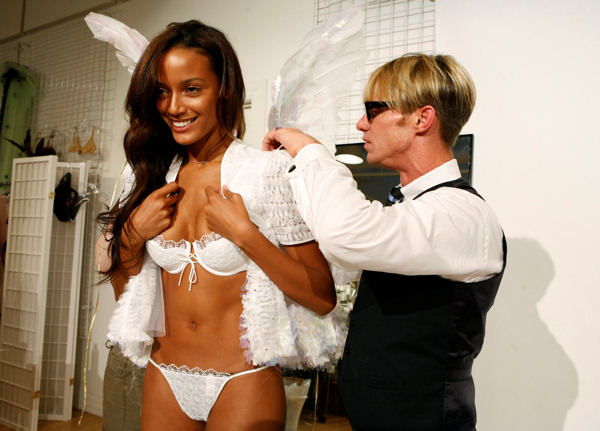 Model Selita Ebanks has her wings adjusted by designer Todd Thomas during a fitting, Tuesday, Nov. 7, 2006, in New York, for an upcoming Victoria Secret fashion show. &#40;AP Photo&#47;Diane Bondareff&#41; <span class=meta>(AP Photo&#47;Diane Bondareff)</span>