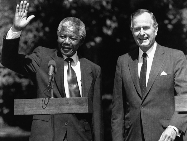 President George Bush greets South African leader Nelson Mandela on the South Lawn of the White House, Monday, June 26, 1990, Washington, DC. (AP Photo/Doug Mills)