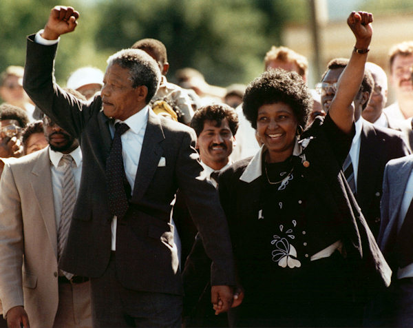 "<div class=""meta ""><span class=""caption-text "">Nelson Mandela and wife Winnie, walking hand in hand, raise clenched fists upon his release from Victor prison, Cape Town, Sunday, February 11, 1990. The African National Congress leader had served over 27 years in detention. (AP Photo) </span></div>"