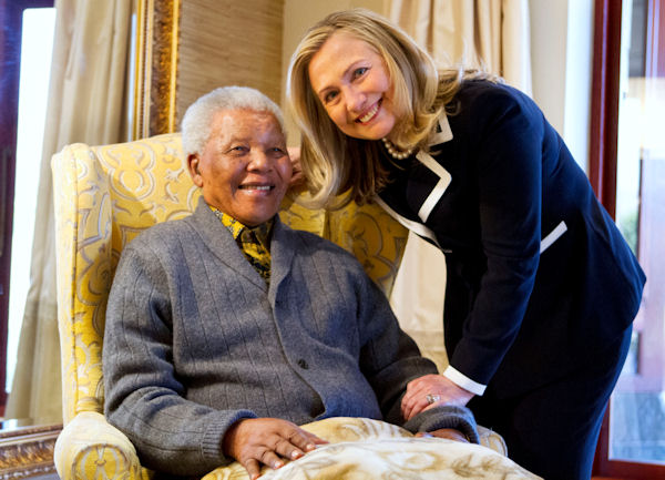 "<div class=""meta ""><span class=""caption-text "">Secretary of State Hillary Rodham Clinton meets with former South Africa President Nelson Mandela, 94, at his home in Qunu, South Africa, Monday, Aug. 6, 2012. (AP Photo/Jacquelyn Martin, Pool)</span></div>"