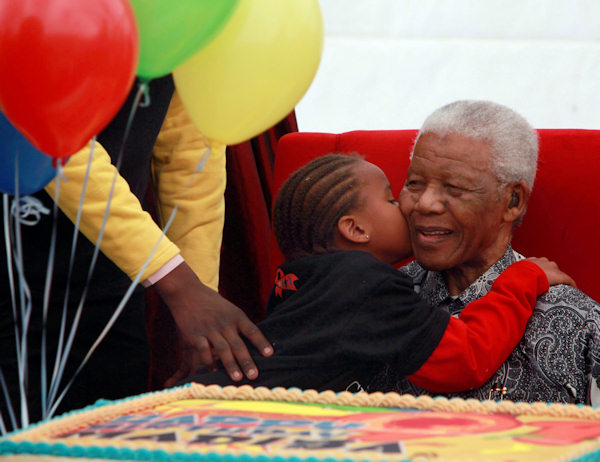 A child kisses Nelson Mandela, Friday, July 31, 2009 during the launch of a children's hospital in Johannesburg, South Africa.. (AP Photo/Karel Prinsloo)