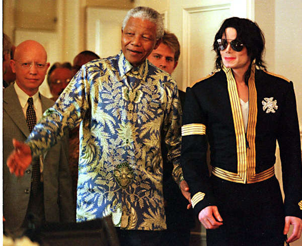 South African President Nelson Mandela, left, and American pop singer Michael Jackson arrive at a news conference in Cape Town Tuesday, March 23, 1999. (AP Photo /Obed Zilwa)