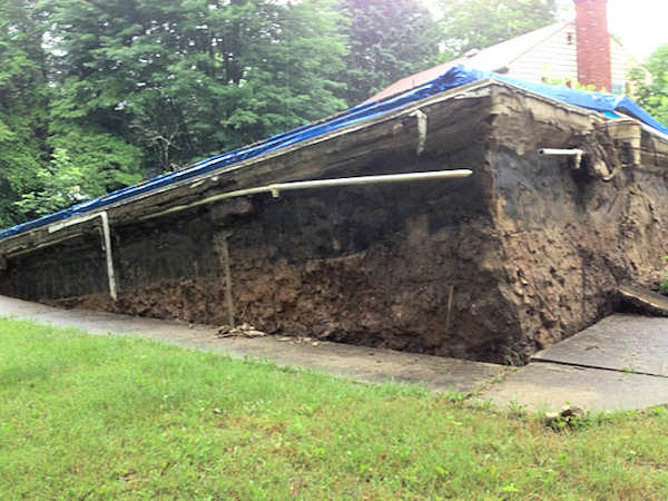 Chester Springs, Pa.: An empty in-ground pool behind the home at 10 Pine Drive popped out of the ground during heavy rain on Monday, June 10, 2013. The home was said to be vacant. <span class=meta>(Action News Viewer Stacey Castro)</span>