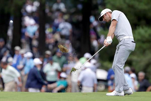 Dustin Johnson hits down the first fairway during the first round of the U.S. Open golf tournament at Merion Golf Club, Thursday, June 13, 2013, in Ardmore, Pa. (AP Photo/Darron Cummings)
