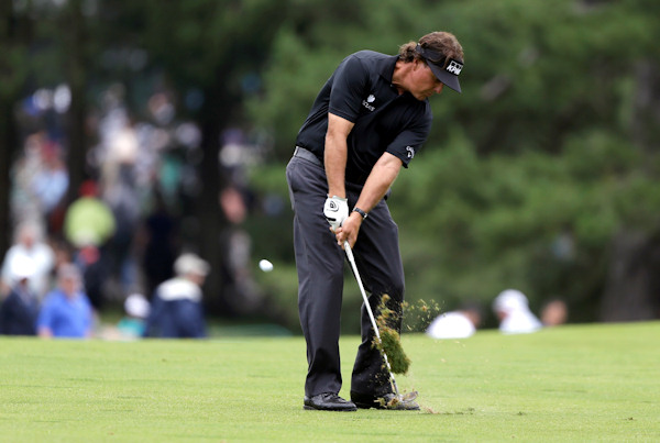 Phil Mickelson hits down the first fairway during the first round of the U.S. Open golf tournament at Merion Golf Club, Thursday, June 13, 2013, in Ardmore, Pa. (AP Photo/Darron Cummings)