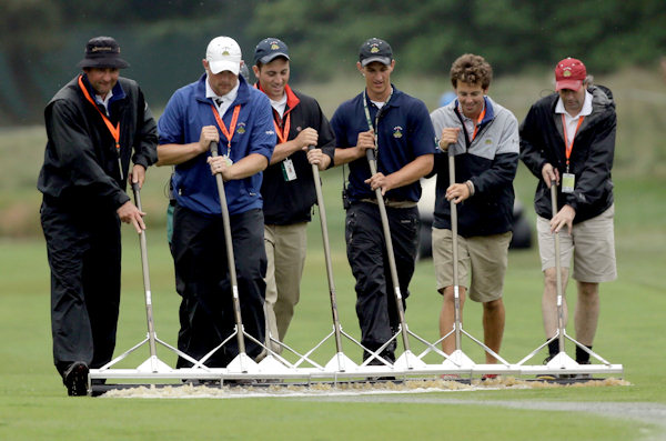 "<div class=""meta ""><span class=""caption-text "">Course workers clear water from the sixth fairway after a weather delay during the first round of the U.S. Open golf tournament at Merion Golf Club, Thursday, June 13, 2013, in Ardmore, Pa. (AP Photo/Julio Cortez)  </span></div>"