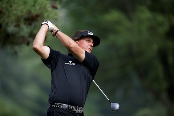 Phil Mickelson tees off on the second hole during the fourth round of the U.S. Open golf tournament at Merion Golf Club, Sunday, June 16, 2013, in Ardmore, Pa. (AP Photo/Morry Gash)