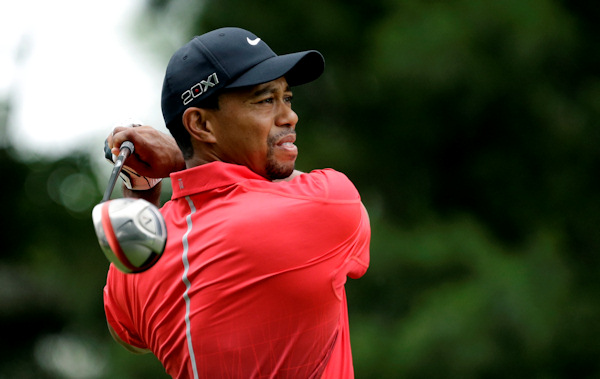 Tiger Woods tees off on the second hole during the fourth round of the U.S. Open golf tournament at Merion Golf Club, Sunday, June 16, 2013, in Ardmore, Pa. (AP Photo/Gene J. Puskar)