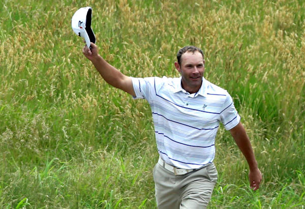 "<div class=""meta ""><span class=""caption-text "">Shawn Stefani acknowledges the gallery after hitting a hole in one on the 17th hole during the fourth round of the U.S. Open golf tournament at Merion Golf Club, Sunday, June 16, 2013, in Ardmore, Pa. (AP Photo/Julio Cortez)       </span></div>"