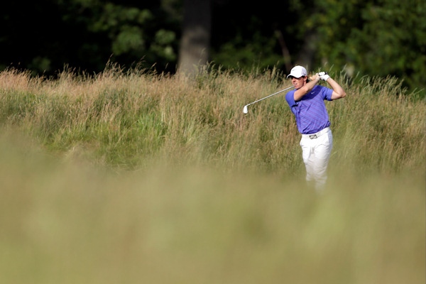 Rory McIlroy, of Northern Ireland, hits down the 14th fairway during the third round of the U.S. Open golf tournament at Merion Golf Club, Saturday, June 15, 2013, in Ardmore, Pa. (AP Photo/Darron Cummings)