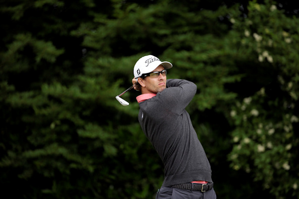 Adam Scott, of Australia, tees off on the 11th hole during the second round of the U.S. Open golf tournament at Merion Golf Club, Friday, June 14, 2013, in Ardmore, Pa. (AP Photo/Gene J. Puskar)