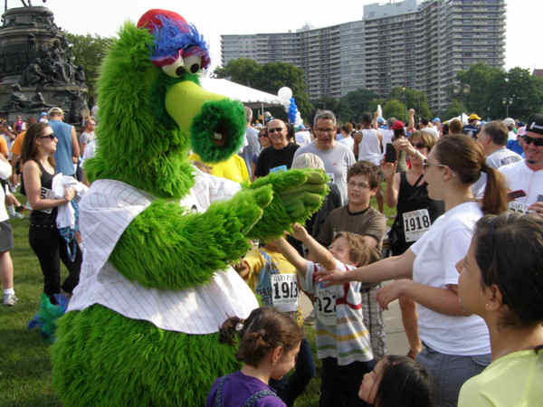 "<div class=""meta image-caption""><div class=""origin-logo origin-image ""><span></span></div><span class=""caption-text"">The Phanatic greets fans after the big race.</span></div>"