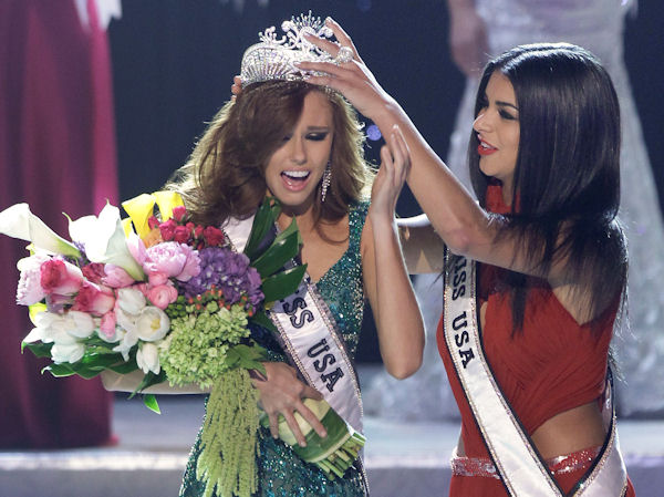 Alyssa Campanella, Miss California, is crowned as the 2011 Miss USA by Miss USA 2010 Rima Fakih, Sunday, June 19, 2011, in Las Vegas. (AP Photo/Julie Jacobson)