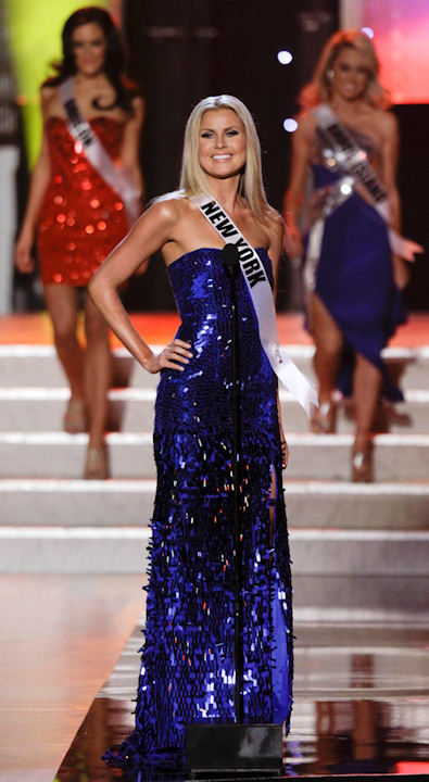 "<div class=""meta ""><span class=""caption-text "">Amber Marie Collins, Miss New York, introduces herself at the start of the Miss USA pageant, Sunday, June 19, 2011, in Las Vegas. (AP Photo/Julie Jacobson) </span></div>"