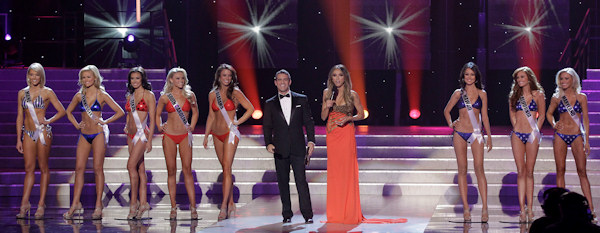 Miss USA hosts Andy Cohen, left center, and Giuliana Rancic introduce the semifinalists during the 2011 Miss USA pageant, Sunday, June 19, 2011, in Las Vegas. From left, they are Miss Maine, Miss Tennessee, Miss Texas, Miss South Carolina, Miss Alabama, Miss Hawaii, Miss California and Miss Maryland. (AP Photo/Julie Jacobson)