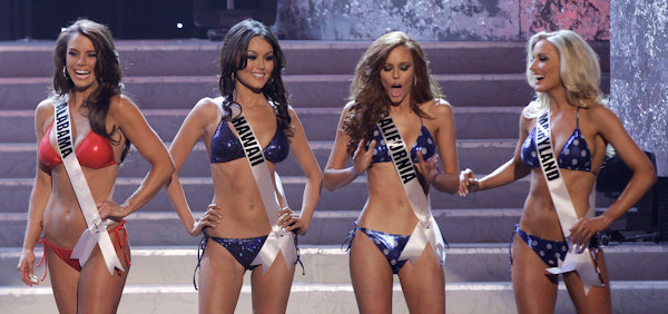 From left, Miss Alabama, Miss Hawaii, Miss California and Miss Maryland react after being named as four of the semifinalists during the 2011 Miss USA pageant, Sunday, June 19, 2011, in Las Vegas. (AP Photo/Julie Jacobson)