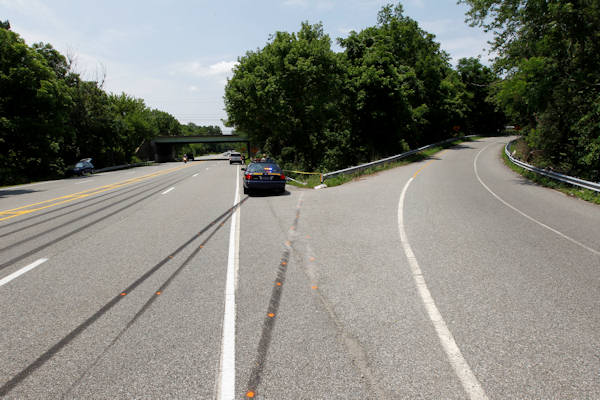 "<div class=""meta image-caption""><div class=""origin-logo origin-image ""><span></span></div><span class=""caption-text"">A police car sits near skid marks leading to the scene of an auto accident Monday, June 20, 2011, in West Chester, Pa. West Goshen Township police say Jackass cast member Ryan Dunn and a passenger died after his car left the roadway and burst into flames. (AP Photo/Matt Rourke)</span></div>"