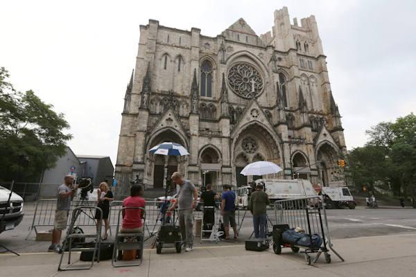 "Reporters set up outside the Cathedral Church of Saint John the Divine for the funeral service for James Gandolfini, Thursday, June 27, 2013 in New York. Gandolfini, who played Tony Soprano in the HBO show ""The Sopranos"", died while vacationing in Italy last week. (AP Photo/Mary Altaffer)"