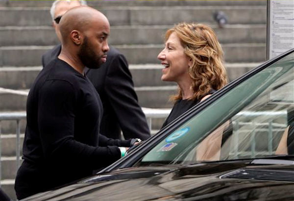 "Actress Edie Falco arrives for the funeral service of James Gandolfini, star of ""The Sopranos,"" in New York's the Cathedral Church of Saint John the Divine, Thursday, June 27, 2013. The 51-year-old actor died of a heart attack last week while vacationing in Italy with his son.(AP Photo/Richard Drew)"