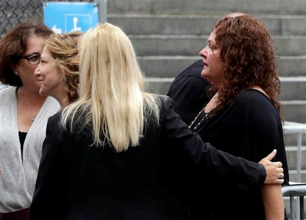 "Actresses Edie Falco, second left, and Aida Turturro, right, arrive for the funeral service of James Gandolfini, star of ""The Sopranos,"" in New York's the Cathedral Church of Saint John the Divine, Thursday, June 27, 2013. The 51-year-old actor died of a heart attack last week while vacationing in Italy with his son.(AP Photo/Richard Drew)"
