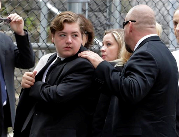 "Michael Gandolfini, left, son of James Gandolfini, arrives for the funeral service of his father, star of ""The Sopranos,"" in New York's the Cathedral Church of Saint John the Divine, Thursday, June 27, 2013. The 51-year-old actor died of a heart attack last week while vacationing in Italy with his son.(AP Photo/Richard Drew)"