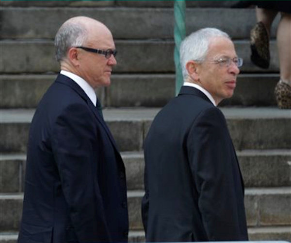 "New York Jets owner Woody Johnson, left, arrives at Cathedral Church of Saint John the Divine for funeral services actor James Gandolfini, Thursday, June 27, 2013, in New York. Gandolfini, who played Tony Soprano in the HBO show ""The Sopranos"", died while vacationing in Italy last week. (AP Photo/Julio Cortez)"