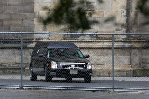 "A hearse arrives at Cathedral Church of Saint John the Divine before funeral services actor James Gandolfini, Thursday, June 27, 2013, in New York. Gandolfini, who played Tony Soprano in the HBO show, ""The Sopranos,""died while vacationing in Italy last week. (AP Photo/Richard Drew)"
