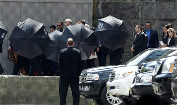 "Men hold umbrellas as pallbearers walk with a casket containing the body of actor James Gandolfini at Cathedral Church of Saint John the Divine after funeral services for Gandolfini, Thursday, June 27, 2013, in New York. Gandolfini, who played Tony Soprano in the HBO show ""The Sopranos"", died while vacationing in Italy last week. (AP Photo/Julio Cortez)"