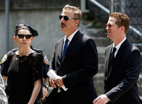 "Actors Julianna Margulies, left, and Chris Noth, center, leave the funeral service of James Gandolfini, star of ""The Sopranos,"" in New York's the Cathedral Church of Saint John the Divine, Thursday, June 27, 2013. The 51-year-old actor died of a heart attack last week while vacationing in Italy with his son.(AP Photo/Richard Drew)"