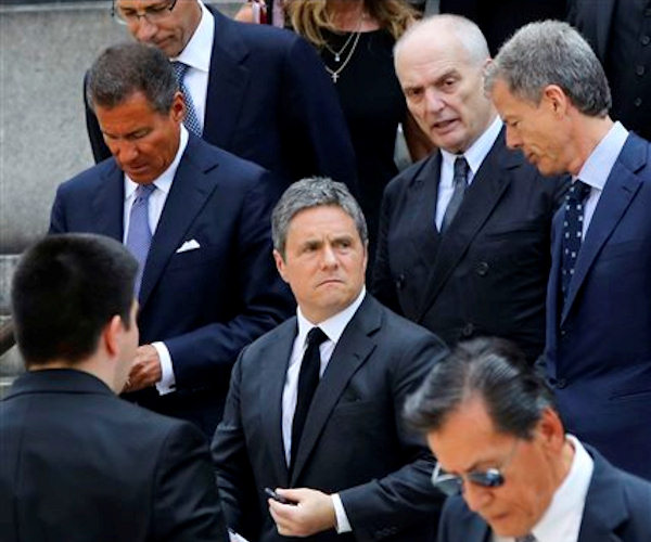 "HBO CEO Richard Plepler, left, Paramount CEO Brad Grey, center, and Soprano's creator David Chase, top second from right, leave the Cathedral Church of Saint John the Divine after the funeral service for James Gandolfini, Thursday, June 27, 2013 in New York. Gandolfini, who played Tony Soprano in the HBO show ""The Sopranos"", died while vacationing in Italy last week. (AP Photo/Mary Altaffer)"