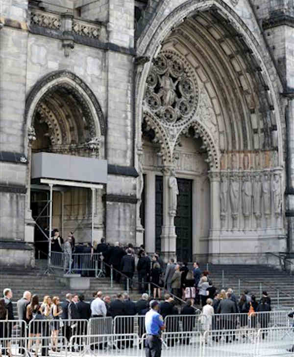 "<div class=""meta ""><span class=""caption-text "">People walk into Cathedral Church of Saint John the Divine during for funeral services actor James Gandolfini, Thursday, June 27, 2013, in New York. Gandolfini, who played Tony Soprano in the HBO show ""The Sopranos"", died while vacationing in Italy last week. (AP Photo/Julio Cortez)</span></div>"