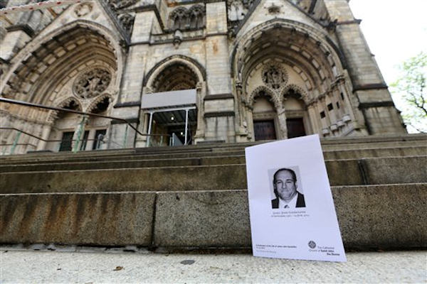 "The program for James Gandolfini's funeral is seen outside the Cathedral Church of Saint John the Divine after his funeral service, Thursday, June 27, 2013 in New York. Gandolfini, who played Tony Soprano in the HBO show ""The Sopranos"", died while vacationing in Italy last week. (AP Photo/Mary Altaffer)"