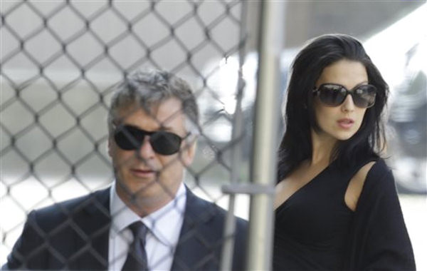 "<div class=""meta ""><span class=""caption-text "">Alec Baldwin, left, and his wife Hilaria Thomas arrive at Cathedral Church of Saint John the Divine before funeral services actor James Gandolfini, Thursday, June 27, 2013, in New York. Gandolfini, who played Tony Soprano in the HBO show ""The Sopranos"", died while vacationing in Italy last week. (AP Photo/Julio Cortez)</span></div>"