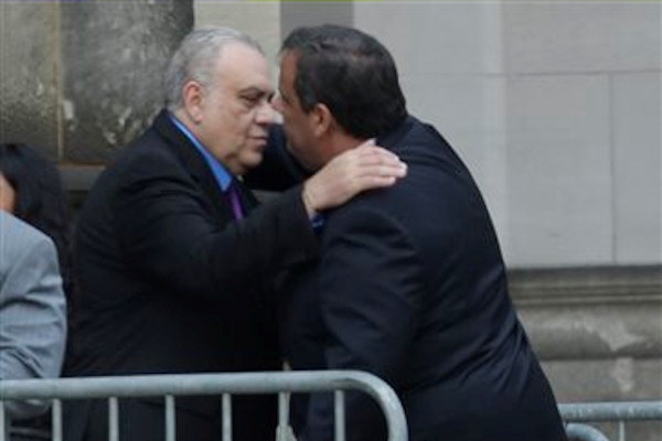 "New Jersey Gov. Chris Christie, right, hugs actor Vincent Curatola outside of Cathedral Church of Saint John the Divine during before services actor James Gandolfini, Thursday, June 27, 2013, in New York. Gandolfini, who played Tony Soprano in the HBO show ""The Sopranos"", died while vacationing in Italy last week. (AP Photo/Julio Cortez)"