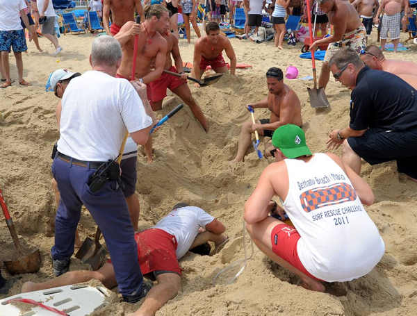 "<div class=""meta image-caption""><div class=""origin-logo origin-image ""><span></span></div><span class=""caption-text""> Authorities say a man was hospitalized after a sand tunnel he was digging at Rehoboth Beach collapsed on top of him. Pictures courtesy of Chuck Snyder.</span></div>"