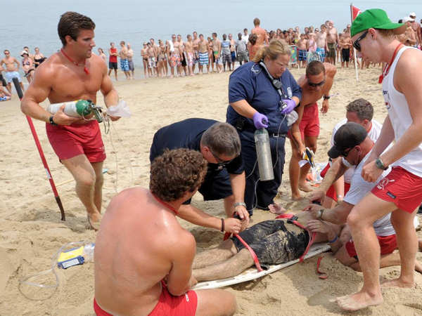 Authorities say a man was hospitalized after a sand tunnel he was digging at Rehoboth Beach collapsed on top of him. Pictures courtesy of Chuck Snyder.