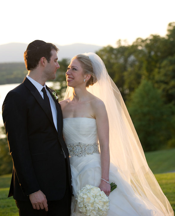 "<div class=""meta image-caption""><div class=""origin-logo origin-image ""><span></span></div><span class=""caption-text"">In this photo provided by Genevieve de Manio Photography, Chelsea Clinton and Marc Mezvinsky are seen during their wedding, Saturday, July 31, 2010 in Rhinebeck, N.Y. Chelsea Clinton wed her longtime boyfriend under extraordinary security at an elegant Hudson River estate late Saturday. ((AP Photo/Genevieve de Manio ))</span></div>"