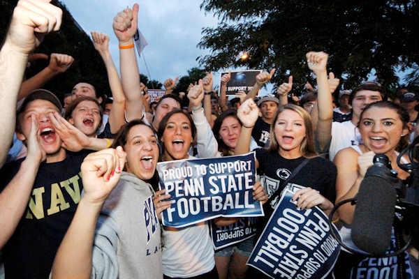 Supporters of the Penn State University football team hold a pep rally outside the Lasch Football Building before the team's morning workout Tuesday, July 31, 2012 in State College, Pa. (AP Photo/Gene J. Puskar)