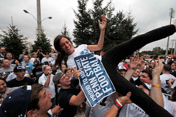 "<div class=""meta ""><span class=""caption-text "">Supporters of the Penn State University football team hold a pep rally outside the Lasch Football Building before the team's morning workout Tuesday, July 31, 2012 in State College, Pa. (AP Photo/Gene J. Puskar)</span></div>"